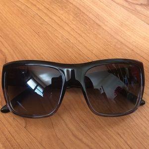 65ee3b9c70 Prada sunglasses. Black frame faded to gray.
